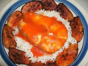 Catfish with rice, stew and plantain