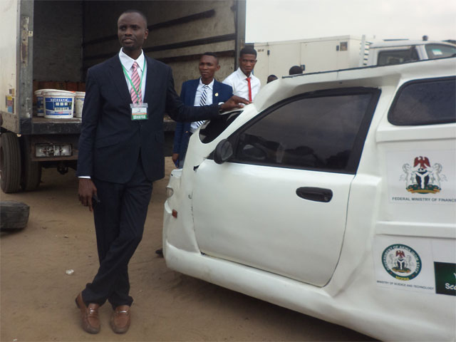 Eniang Nkereuwem Archibong of Enelec GS Nigeria standing by his solar powered vehicle