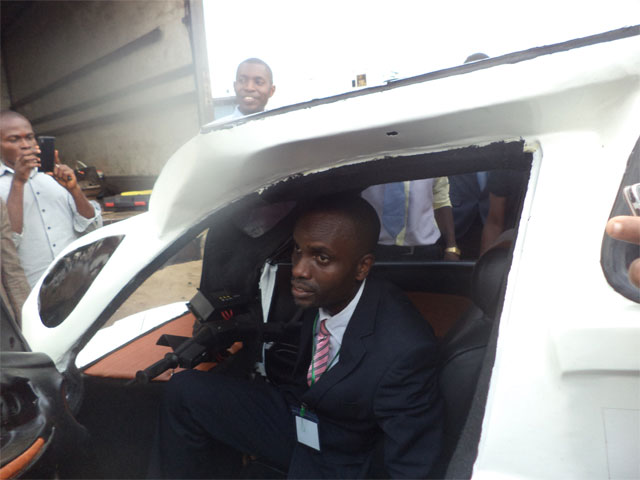 Eniang Nkereuwem Archibong of Enelec GS Nigeria sitting in his solar powered vehicle