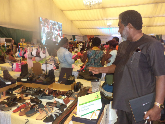 A buyer inspecting leather works by Yasco Footwear Technology at the trade exhibition